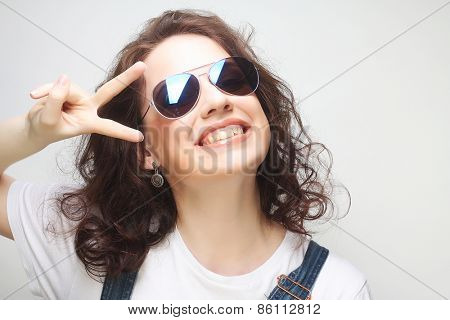 Young surprised woman wearing sunglasses. Emotional portrait.