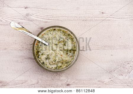 Nettle Soup In Bowl On Wooden Background