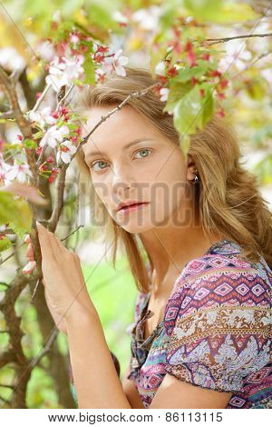 Woman in front of sakura spring blossoms