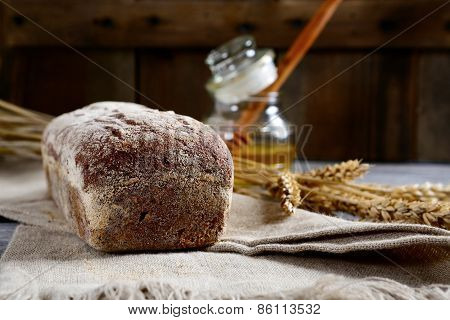 Wheat Bread And Honey On A Sacking