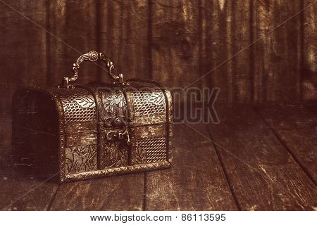 Closed Treasure Chest Standing On Wooden Table