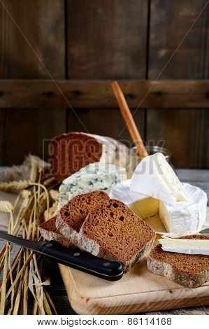 Slices Of Rye Bread, Camembert Cheese And Roquefort