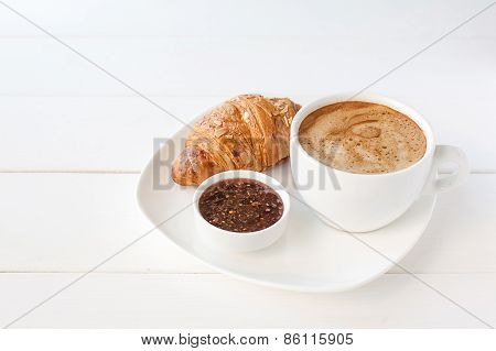 Breakfast with croissant and cup of coffee