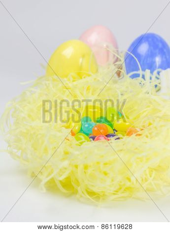 Colorful Easter Eggs And Jelly Belly In Nest