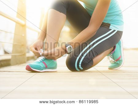 Young Healthy Active Woman Tying Her Shoe Laces
