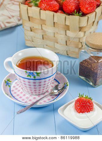 A Cup Of Redbush Tea With A Strawberry-yogurt Dessert