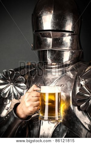 Knight Wearing Armor And Holding Mug Of Beer