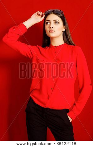 Beautiful girl in a red shirt