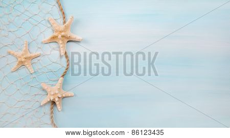Blue turquoise background with starfishes or shells.