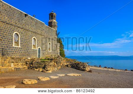 Sea of Galilee in Israel. The Church of the Primacy - Tabgha. The Holy Church was built on the Sea Gennesaret. Jesus then fed with bread and fish hungry people