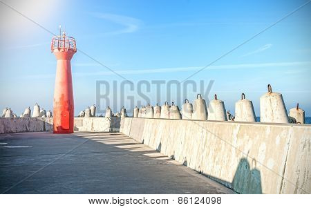 Photo Of A Lighthouse And Concrete Block Breakwater.