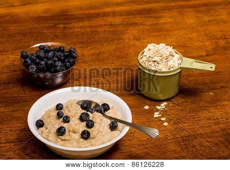 Oatmeal On Wood Tabel With Blueberries