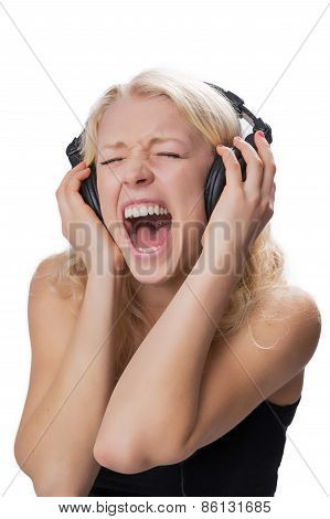 Young Blond Girl Wearing Headphones, Screaming