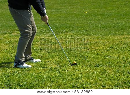 Photo of a golfer on the green preparing to put.