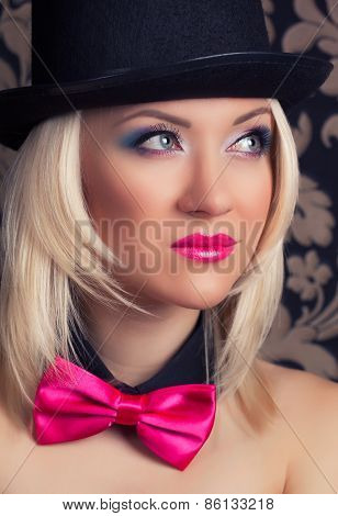 Beautiful Cabaret Woman Wearing Tophat, Bow-tie And Corset Against Retro Wallpapers
