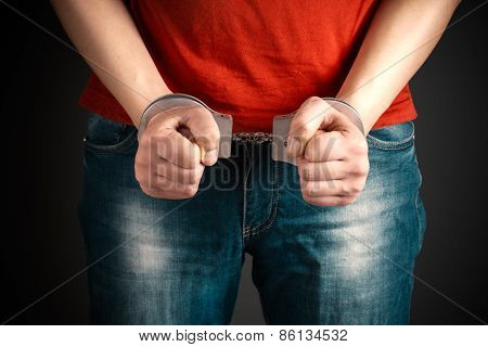 Man Hands In Handcuffs