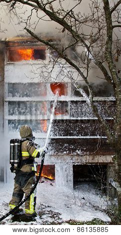 Fireman Put Out Fire With Foam