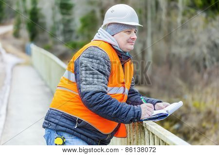 Engineer with documentation on the bridge