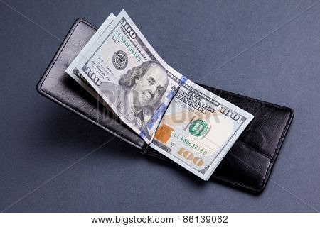 Purse With Hundred Dollar Banknotes On Grey Background