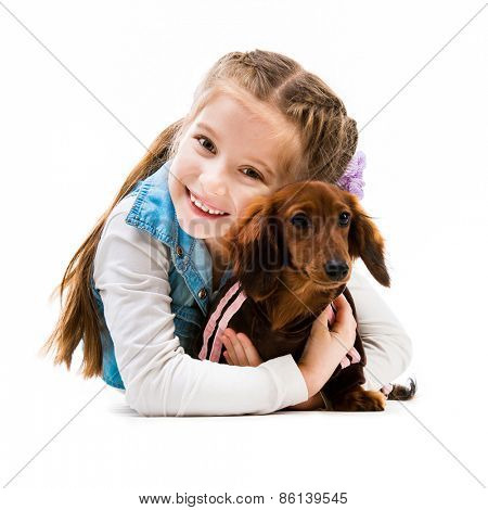 happy little girl with her dachshnd in the