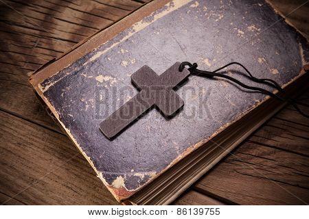 Closeup Of Wooden Christian Cross On Bible