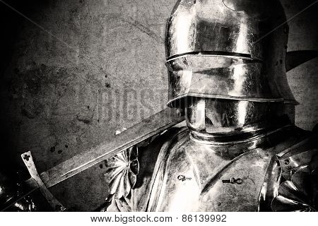 Knight Wearing Armor And Holding Two-handed Sword On His Shoulder
