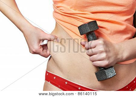 Woman With Dumbbell Showing Fatty Deposits On Waist