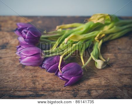 Dead Flowers On Wooden Table