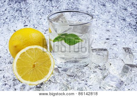 Closeup Of Drink With Citrus Fruit And Ice - Stock Image