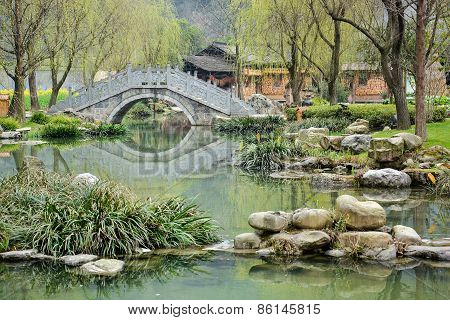 Chinese Garden With Ancient Stone Bridge