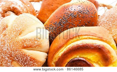 Fresh Sweet Buns And Rolls With Poppy And Cream
