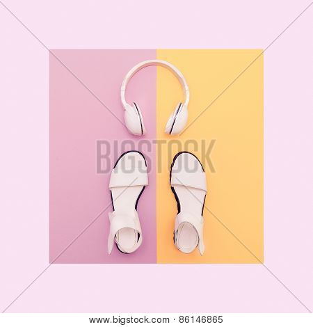 Fashion White Sandals And Headphones On Vanilla Background. Urban Summer Time
