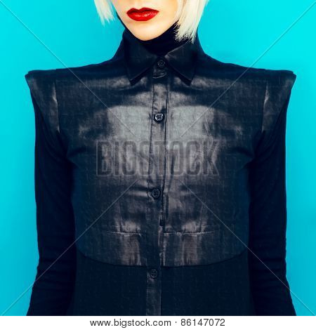 Blonde Girl In Fashionable Black Shirt On Blue Background