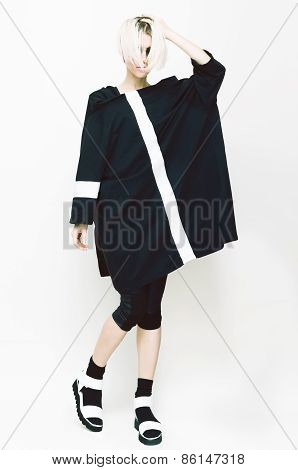 High Fashion Look. Girl On White Background. Fashionable Clothing. Urban Modern Style