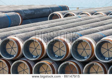 Stacked Pipeline Tubes Lay In Outdoor Storage