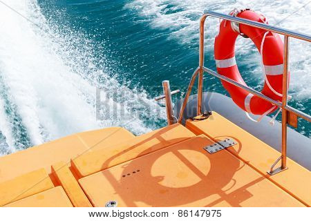 Red Lifebuoy Hanging On Railings Of Rescue Boat
