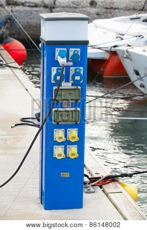 Blue Power Supply Case Stands On Floating Pier