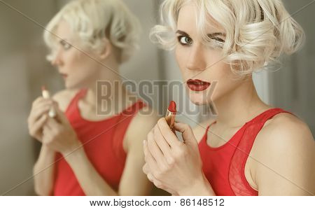 .sensual Blond Lady With Red Lipstick. Reflection In The Mirror