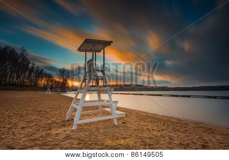 Lifeguard Hut On Lake Shore. Long Exposure Photo