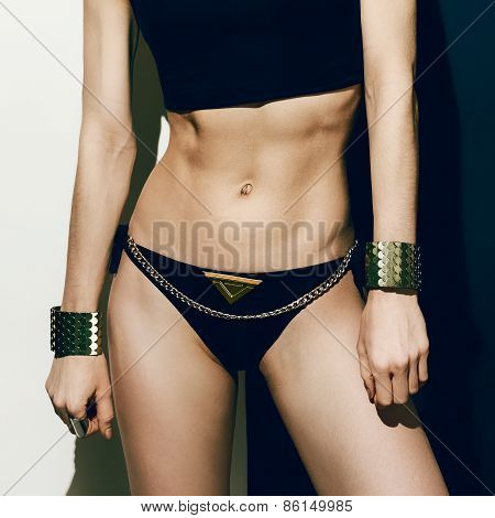.sexy Sports Girl In Fashionable Clothes. Metal,, Glamour, Luxury
