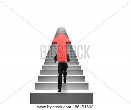 Businessman Carrying Red Arrow Sign On Stairs With White Background