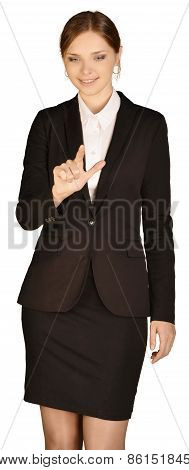 Young girl dressed in a suit presses forefinger in the empty space