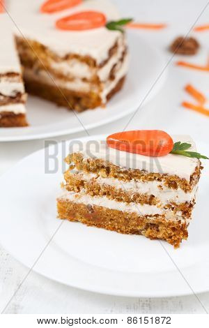 Tasty homemade carrot sponge cake with little orange carrots on top