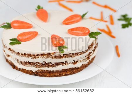 Delicious cheese cake with little carrots and cream op top