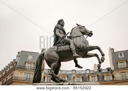Place Des Victoires In Paris With The Equestrian Monument In Honor Of King Louis Xiv