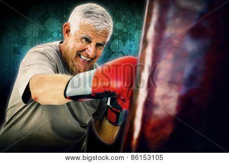 Portrait of a determined senior boxer against dark background