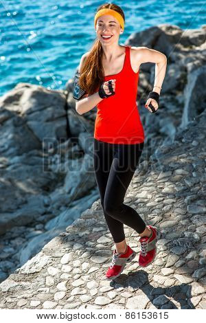 Sport woman running near the sea
