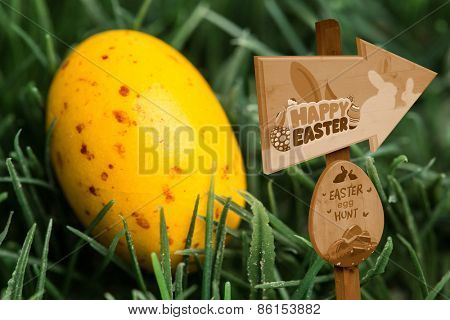 Easter egg hunt sign against yellow speckled easter egg