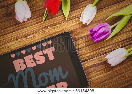 best mom ever against tulips on desk