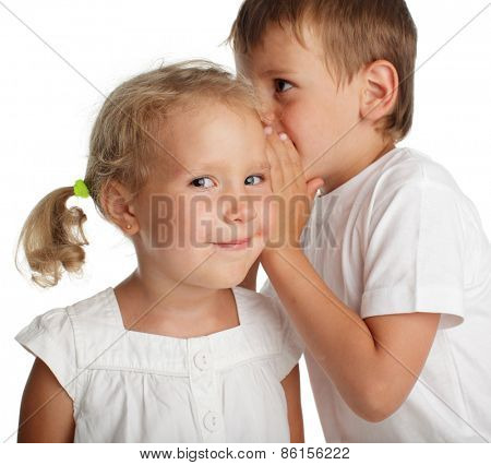 Boy whispers a secret to the girl